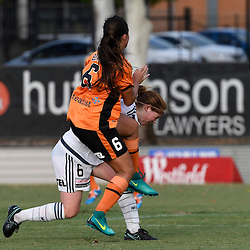 BRISBANE, AUSTRALIA - JANUARY 1: Angela Beard of the Roar and Annabel Martin of the Victory compete for the ball during the round 10 Westfield W-League match between the Brisbane Roar and Melbourne Victory at AJ Kelly Park on January 1, 2016 in Brisbane, Australia. (Photo by Patrick Kearney/Brisbane Roar)