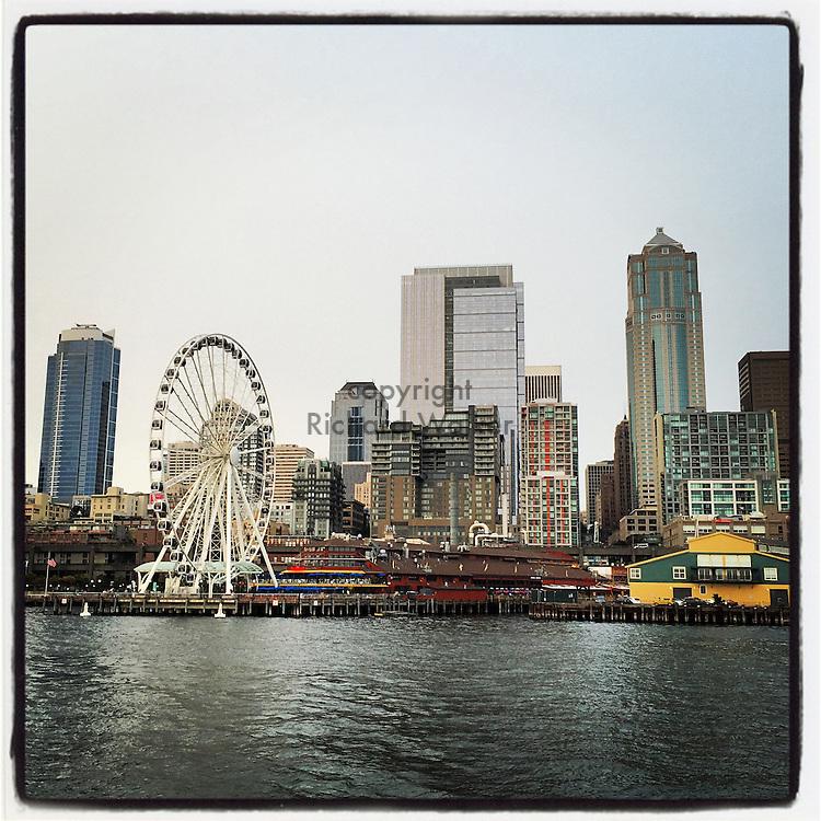 2015 July 07 - Downtown waterfront as seen from Elliott Bay, Seattle, WA, USA. Taken/edited with Instagram App for iPhone. By Richard Walker