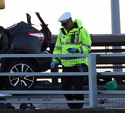 © Licensed to UK  News in Pictures. Port of Dover Kent Monday 3rd July 2017  Two People have been left fighting for their lives after an over sea lorry driver ploughed into  their vehicle minutes after the pair had return from a weekend away.  The Romanian registered lorry was fallen laden on route to the ferry just after midnight on Sunday witnesses say the driver was on the wrong side of the road driving to the port when the incident happened late on Sunday evening. The main A2 into the port of Dover has been closed for nearly six hours and is likely to remain closed to aid with Police investigations and recovery of the lorry and the vehicle. Fire crews from Kent fire and rescue used specialist cutting equipment to gain access to the vehicle by removing the roof.©UKNIP