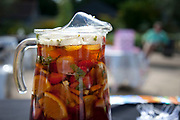 A summer outdoor garden party with jugs of Pimms for the guests. Traditional English afternoon tea at the Herb Garden, Battersea Park.