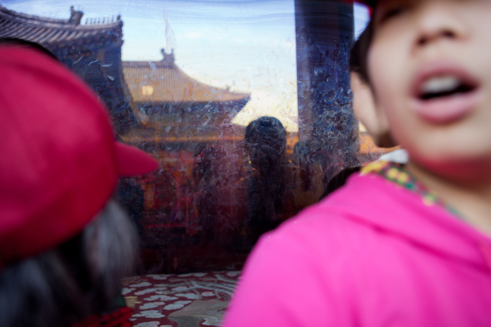 """Reflection in a glass window protecting one temple at """"The Forbidden City"""" which was the Chinese imperial palace from the Ming Dynasty to the end of the Qing Dynasty. It is located in the middle of Beijing, China. Beijing is the capital of the People's Republic of China and one of the most populous cities in the world with a population of 19,612,368 as of 2010."""