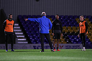 AFC Wimbledon striker Ollie Palmer (9) , AFC Wimbledon defender Terell Thomas (6) and AFC Wimbledon defender Archie Proctor (25) listening to manager during the test event for AFC Wimbledon held at the new Plough Lane Stadium, London, United Kingdom on 2 November 2020.