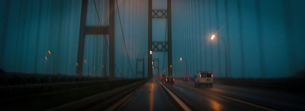 panoramic image while driving across the northbound span of the Tacoma Narrows Bridge in the rain at night, Tacoma, WA, USA