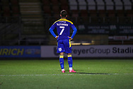 AFC Wimbledon midfielder Cheye Alexander (7) stood alone with hands on hips during the EFL Trophy match between Leyton Orient and AFC Wimbledon at the Breyer Group Stadium, London, England on 6 October 2020.