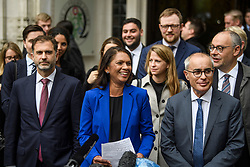 © Licensed to London News Pictures. 24/09/2019. London, UK. Businesswoman GINA MILLER (centre) is seen smiling while speaking to media as she leaves The Supreme Court in London with her lawyer LORD DAVID PANNICK QC (right) following a ruling on an appeal against a judicial review of Boris Johnson's suspension of Parliament. The case has been brought by remain campaigner Gina Miller, with support from former British Prime Minister John Major. Photo credit: Ben Cawthra/LNP