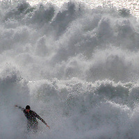 A surfer gets a foam rinse as a large swell pours into Steamer Lane in Santa Cruz, California on Tuesday January 16, 2018.<br /> Photo by Shmuel Thaler <br /> shmuel_thaler@yahoo.com www.shmuelthaler.com