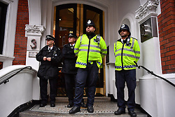 © Licensed to London News Pictures. 14/11/2016. London, UK. Police stand guard at the entrance to the Ecuadorian embassy after Swedish officials arriVed to interview WikiLeaks editor-in-chief, Julian Assange. Assange, who has been living at the embassy for over four years, is wanted for questioning over accusations of rape in Stockholm in 2010.  Photo credit: Ben Cawthra/LNP
