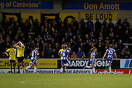 Wigan Athletic defender Callum Connolly(12) scores for Wigan and celebrates making the score 2-0 to Wigan  during the EFL Sky Bet Championship match between Burton Albion and Wigan Athletic at the Pirelli Stadium, Burton upon Trent, England on 14 January 2017. Photo by Richard Holmes.