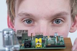 Teenage boy with computer motherboard
