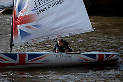 © Licensed to London News Pictures. 16/08/2012. LONDON, UK. Olympic Gold medalist Ben Ainslie sails his boat Rita on the River Thames in London today (16/08/12) to celebrate his sailing win at the London 2012 Olympics. The medal, won competing in the Finn Class sailing event, is Ainslie's fourth Olympic Gold making him the history's most successful Olympic sailor. Photo credit: Matt Cetti-Roberts/LNP