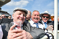 National Hunt Horse Racing - 2019 Randox Health Grand National Festival - Saturday, Day Three (Grand National Day)<br /> <br /> male racegoers in the sunshine before  the 1.45 Gaskells Handicap Hurdle (Grade 3) (Class 1)<br /> at Aintree Racecourse.<br /> <br /> COLORSPORT/WINSTON BYNORTH