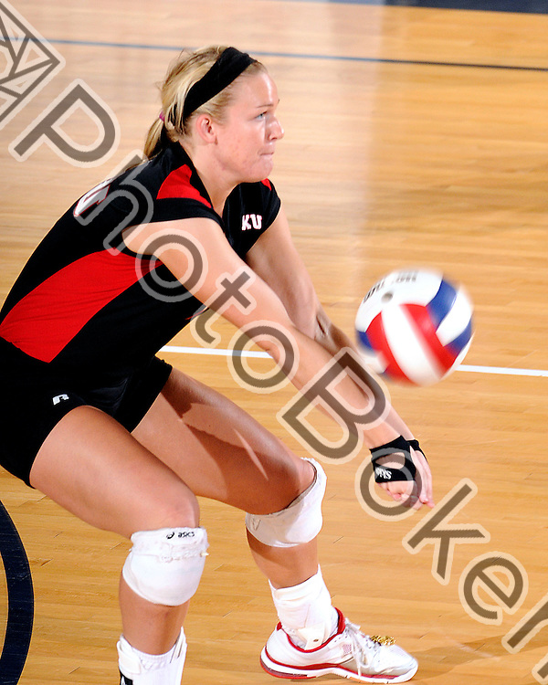 2011 November 18 - WKU defensive specialist Sarah Rogers (1) returning a volley. Western Kentucky Hilltoppers defeated the Blue Raiders of Middle Tennessee, 3-1, in the championship match of the 2011 Sunbelt Volleyball Tournament, at the U.S. Century Bank Arena, Miami, Florida. (Photo by: www.photobokeh.com / Alex J. Hernandez) 1/250 f/7.1 ISO400 450mm