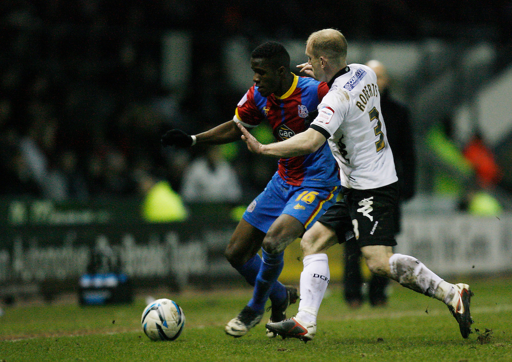 Crystal Palace's Wilfried Zaha (L) and Derby County's Gareth Roberts in action   ...Football - npower Football League Championship - Derby County v Crystal Palace - Friday 01st March 2013 - Pride Park - Derby..© CameraSport - 43 Linden Ave. Countesthorpe. Leicester. England. LE8 5PG - Tel: +44 (0) 116 277 4147 - admin@camerasport.com - www.camerasport.com