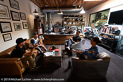 A regular strategy meeting in Roland's office at his Roland Sands Design (RSD) retail and office location, Los Alamitos, CA. Monday June 25, 2018. Photography ©2018 Michael Lichter.