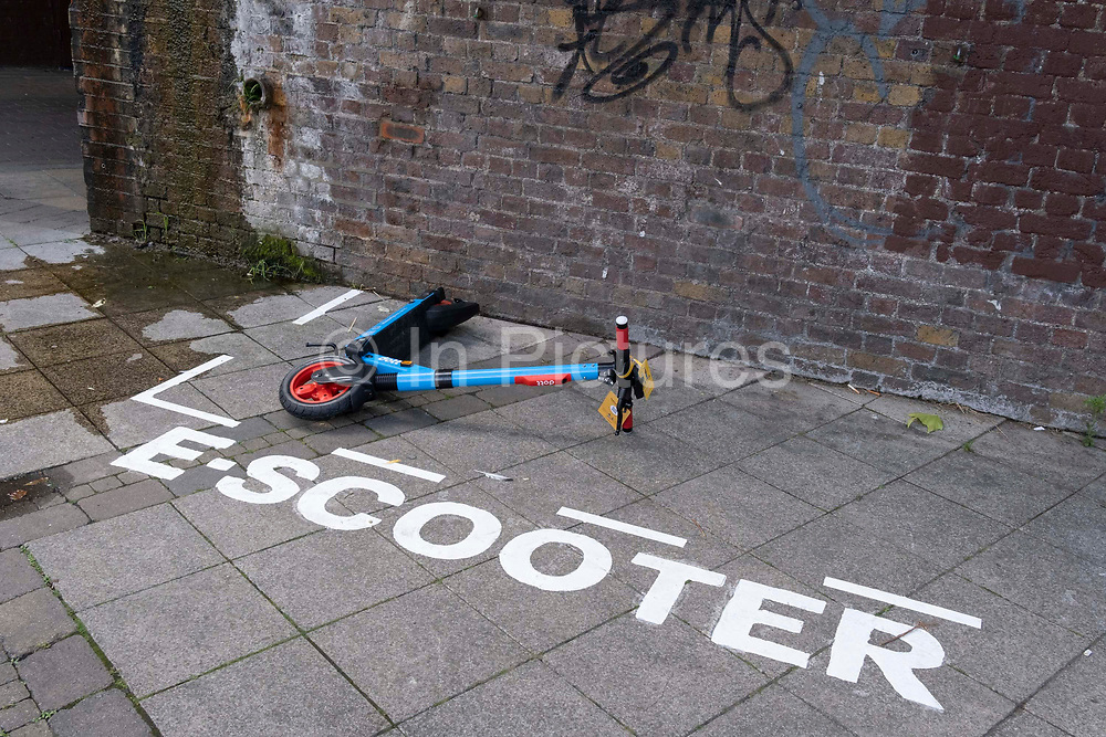 A Dott eScooter has fallen over within a special area for licensed and therefore legal rental eScooters, in Waterloo, SE1, on 8th July 2021, in London, England.
