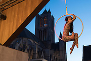Acrobatic woman dressed up as a cat bringing her act during Ghent festivities at the city pavilion, ghent, belgium, 16.07.2016