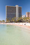 A tall hotel on Waikiki Beach.