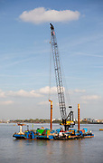 The floating crane barge next to the Woolwich Ferry terminal that will carry out upgrade work on the ferry pontoons, seen on the River Thames, on October 05, 2018 in London, England on the final day of operation with the old boats.  The Woolwich ferry river crossing service closes from Saturday 6th October until the end of the year to allow new pontoons to be constructed for new boats and the ferry is planned to resume at the end of the year.