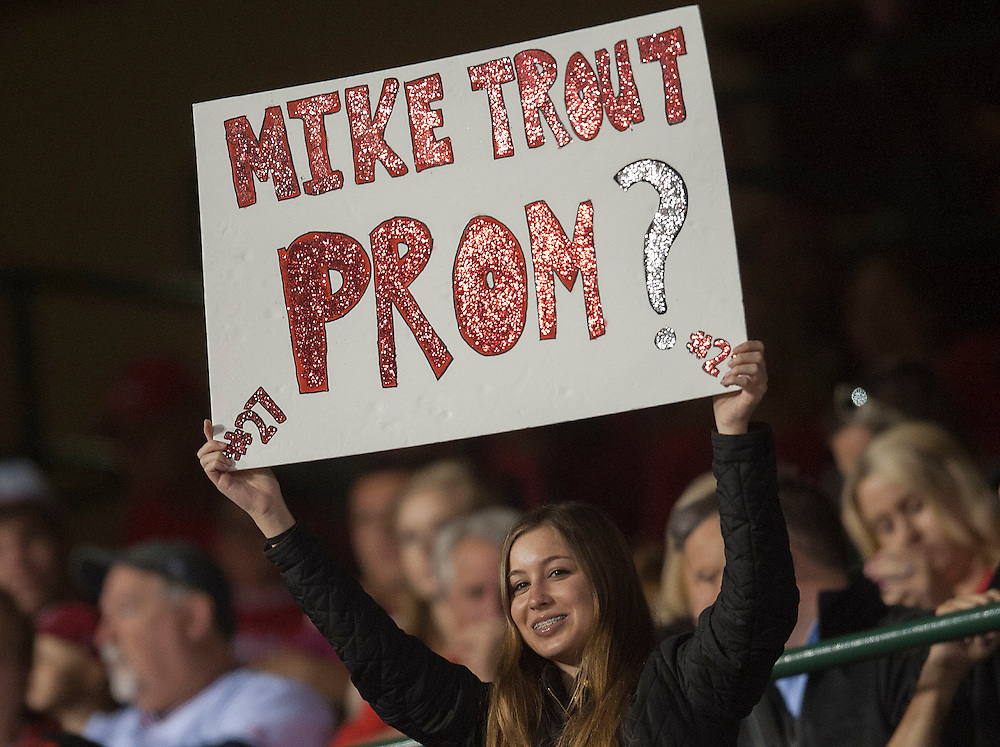 A Mike Trout fan looks for a prom date during the Angels' 9-4 victory over the Kansas City Royals Tuesday night at Angel Stadium.<br /> <br /> <br /> ///ADDITIONAL INFO:   <br /> <br /> angels.0427.kjs-pre  ---  Photo by KEVIN SULLIVAN / Orange County Register  --  4/26/16<br /> <br /> The Los Angeles Angels take on the Kansas City Royals Tuesday at Angel Stadium.<br /> <br /> <br />  4/26/16