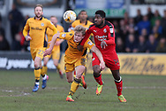 Andre Blackman of Crawley Town ® challenges for the ball with Alex Samuel of Newport county.  EFL Skybet football league two match, Newport county v Crawley Town at Rodney Parade in Newport, South Wales on Saturday 1st April 2017.<br /> pic by Andrew Orchard, Andrew Orchard sports photography.