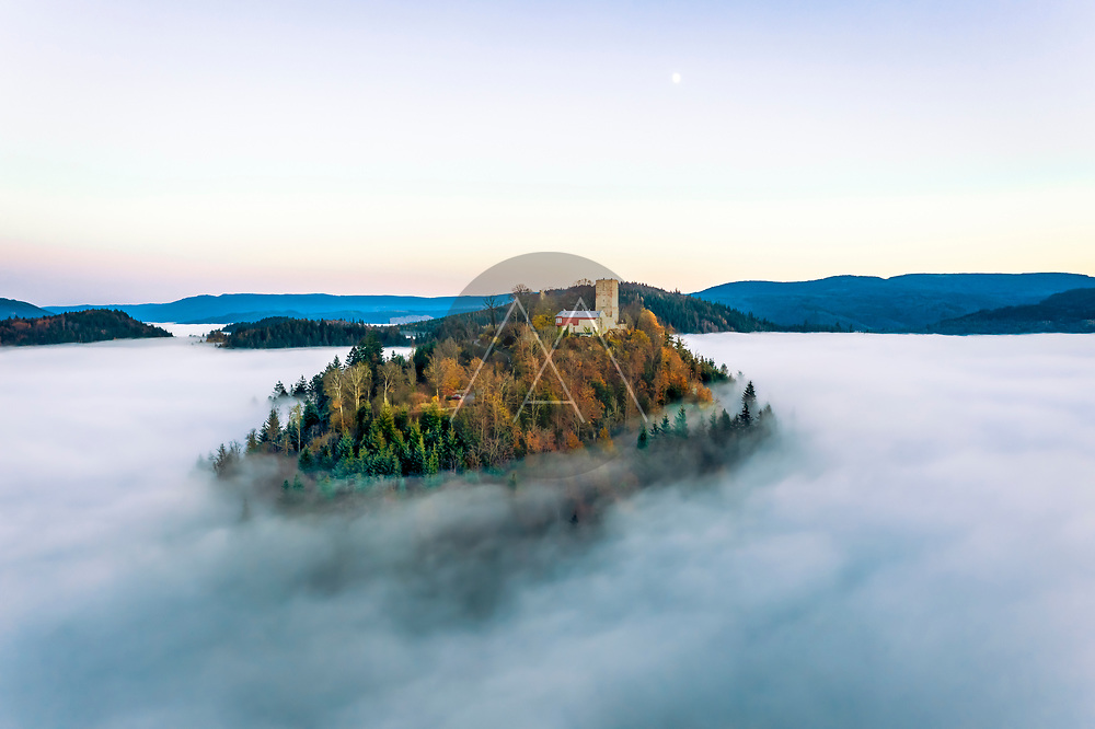 Panoramic aerial sunset view of the castle Yburg with floating fog in autumn, Varnhalt, Black Forest, Baden Baden, Baden Wine Route, Germany.