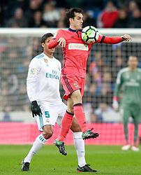 Real Madrid's Raphael Varane (l) and Real Sociedad's Juanmi Jimenez during La Liga match. Madrid, Spain, on February 10, 2018. Photo by Acero/AlterPhotos/ABACAPRESS.COM