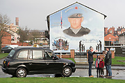 Taxi guided tours around Belfast murals. A staunch unionist area. Shankhill Road estate, Belfast. It is a staunch unionist area, fiercely pro-Britain. Their representatives, the Democratic Unionist Party, founded by Ian Paisley in 1971, are presently in parliament in collusion with the conservative party, looking for a hard Brexit with a border between Northern Ireland and the South. The ten DUP votes gives the conservative party its majority in government. This is nothing new. During the 'Troubles' three decades of bloodshed, with Catholic Irish Republican Nationalists seeking to unit Ireland, the pro-British Protestant loyalists wanted to remain part of the United Kingdom