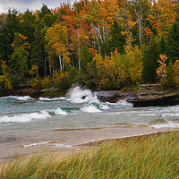 """""""Autumn Color and Waves""""<br /> <br /> Beautiful fall color mixed in with evergreen trees along the shores of Lake Superior with waves crashing against the rocks!"""