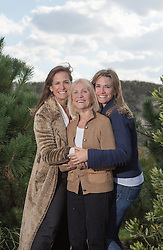senior woman with her two grown daughters outdoors