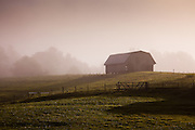 An old barn in the morning mist Brevard, NC in the Blue Ridge mountains of western North Carolina.