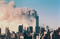 11 September 2001. New York, New York - USA.<br /> 9/11 World Trade Center attack.<br /> Looking across New York to the World Trade Center immediately after Al Queda's coordinated terror attack on the Twin Towers in a sequence of photographs which first shows the towers on fire, then the first and second tower collapsing. <br /> Photo collect courtesy of tourist Ben Shenkar<br /> Photo exclusive©; Ben Shenkar as supplied by Charlie Varley/varleypix.com