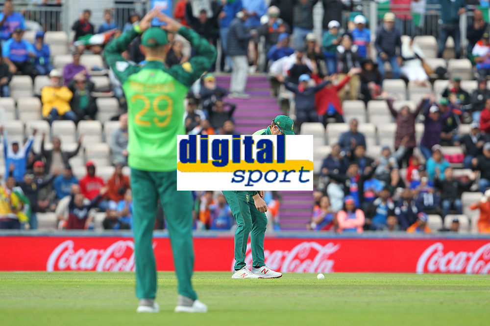 Cricket - 2019 ICC Cricket World Cup - Group Stage: South Africa vs. India<br /> <br /> David Miller of South Africa looks down at the ball after dropping an easy catch off Rohit Sharma of India during the cricket world cup match at the Hampshire Bowl Southampton England<br /> <br /> COLORSPORT/SHAUN BOGGUST
