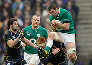 09.02.2013 Edinburgh, Scotland.   Peter O'Mahony of Ireland gets to the ball ahead of Scotland's Rob Harley during the RBS Six Nations Championship match between Scotland and Ireland, from Murrayfield Stadium.