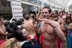 © licensed to London News Pictures. London, UK 12/05/2012. 100 Lifeguards walking on Regent Street as they promote opening of the new Gilly Hicks and Hollister Flagship Stores on Regent Street, this morning (12/05/12). Photo credit: Tolga Akmen/LNP