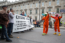 London, UK. 7 October, 2019. Performers from Extinction Empire entertain climate activists from Extinction Rebellion blocking Whitehall on the first day of International Rebellion protests to demand a government declaration of a climate and ecological emergency, a commitment to halting biodiversity loss and net zero carbon emissions by 2025 and for the government to create and be led by the decisions of a Citizens' Assembly on climate and ecological justice.