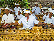 19 JULY 2016 - TAMPAKSIRING, GIANYAR, BALI, INDONESIA:  A gamelan orchestra performs on the first day of a ceremony to honor the anniversary Pura Agung temple, one of the most important Hindu temples on Bali. This year's ceremony is the most important in years because it falls on the 50 year cycle of the temple's founding. This year's ceremony lasts for 11 days.     PHOTO BY JACK KURTZ