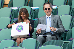 © Licensed to London News Pictures. 11/07/2018. London, UK. Ms Binti Velani and Richard E. Grant watches centre court tennis in the royal box at the Wimbledon Tennis Championships 2018, at the All England Lawn Tennis and Croquet Club. Photo credit: Ray Tang/LNP