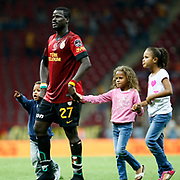 Galatasaray's Emmanuel Eboue with childrens during their Turkish Super League soccer match Galatasaray between Bursaspor at the TT Arena at Seyrantepe in Istanbul Turkey on Sunday 02 September 2012. Photo by TURKPIX