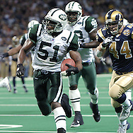 New York Jets linebacker Jonathan Vilma (51) returns a interception 38-yards for a Jets touchdown, during the third quarter, giving the Jets a 26-21 lead over the St. Louis Rams.  The Rams won in overtime 32-29 in St. Louis, Missouri, January2, 2005.