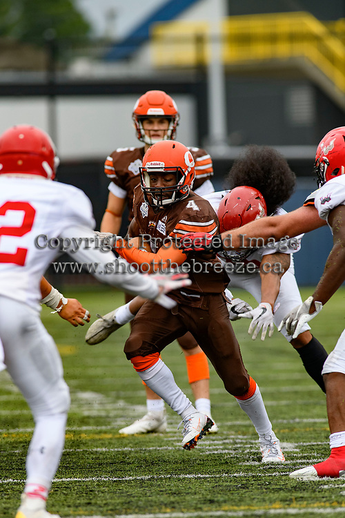 CHILLIWACK, BC - SEPTEMBER 11: Jevan Garwood #4 of Okanagan Sun runs with the ball against the Westshore Rebels at Exhibition Stadium in Chilliwack, BC, Canada. (Photo by Marissa Baecker/Shoot the Breeze)