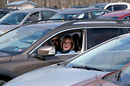 A parishioner sings while in her car during Bethany Wesleyan Church's Sunday worship service Mar. 22, 2020, at Becky's Drive-In in Walnutport, Pennsylvania. Concerns over the coronavirus have closed churches in an effort to avoid gatherings of large crowds.