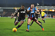 Stephen Dawson of Scunthorpe United and Donervon Daniels of Wigan Athletic during the Sky Bet League 1 match between Scunthorpe United and Wigan Athletic at Glanford Park, Scunthorpe, England on 2 January 2016. Photo by Ian Lyall.