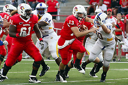 10 September 2011: Matt Brown runs on a keeper play and is held up by Aaron Meadows during an NCAA football game between the Morehead State Eagles and the Illinois State Redbirds at Hancock Stadium in Normal Illinois.