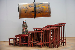 © Licensed to London News Pictures. 23/08/2021. LONDON, UK.  A staff member poses with untitled works at the preview of ARTIST ROOMS: Phyllida Barlow, a new exhibition of work by British artist Phyllida Barlow which includes several large-scale installations and a selection of drawings across her sixty-year career.  Photo credit: Stephen Chung/LNP