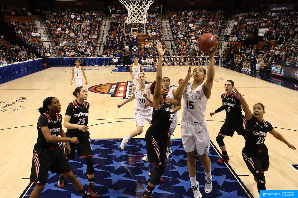 Gabby Williams, UConn, shoots while challenged by Marley Hill, Cincinniti, during the UConn Vs Cincinnati Quarterfinal Basketball game at the American Women's College Basketball Championships 2015 at Mohegan Sun Arena, Uncasville, Connecticut, USA. 7th March 2015. Photo Tim Clayton