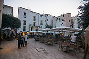Citizens and tourists join together in the central square of the village of Sperlonga, Italy. Sperlonga is a coastal town in the province of Latina, Italy, about halfway between Rome and Naples.