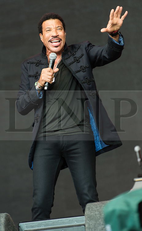 © Licensed to London News Pictures. 28/06/2015. Pilton, UK. Lionel Richie performing at Glastonbury Festival 2015 on Sunday Day 5 of the festival on the The Pyramid Stage stage.  This years headline acts include Kanye West, The Who and Florence and the Machine, the latter being upgraded in the bill to replace original headline act Foo Fighters.  Photo credit: Richard Isaac/LNP