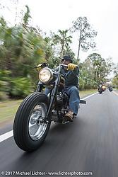 Nick Jordan of Aynor, SC riding his 1973 Harley-Davidson Speedking Shovel Chopper (built by Jeff Cochran) through Tomoka State Park during Daytona Beach Bike Week. FL. USA. Tuesday, March 14, 2017. Photography ©2017 Michael Lichter.