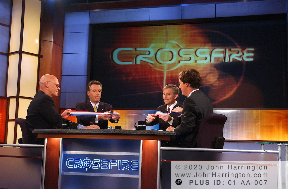 DNC Chairman Terry McAuliffe and RNC Chairman Marc Racicot cut the ribbon on the new CNN Crossfire as co-hosts James Carville and Tucker Carlson hold the ribbon.  CNN's Crossfire debuts in its new 7pm timeslot and has expanded to an hour-long format, in front of a live studio audience at The George Washington University.