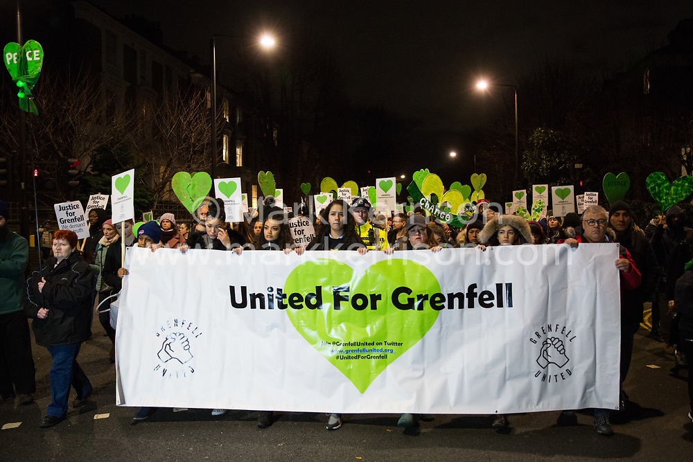 London, UK. 14th January, 2019. Members of the Grenfell community take part in the Grenfell Silent Walk around North Kensington on the monthly anniversary of the fire on 14th June 2017. 72 people died in the Grenfell Tower fire and over 70 were injured.